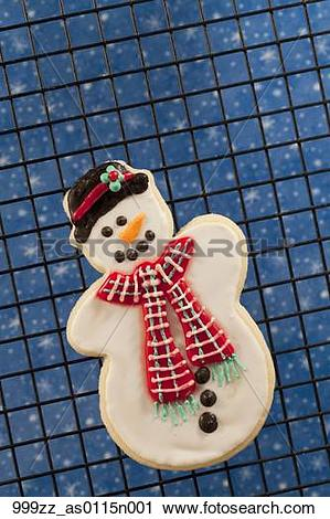 Stock Photography of Closeup of a homemade sugar cookie snowman on.