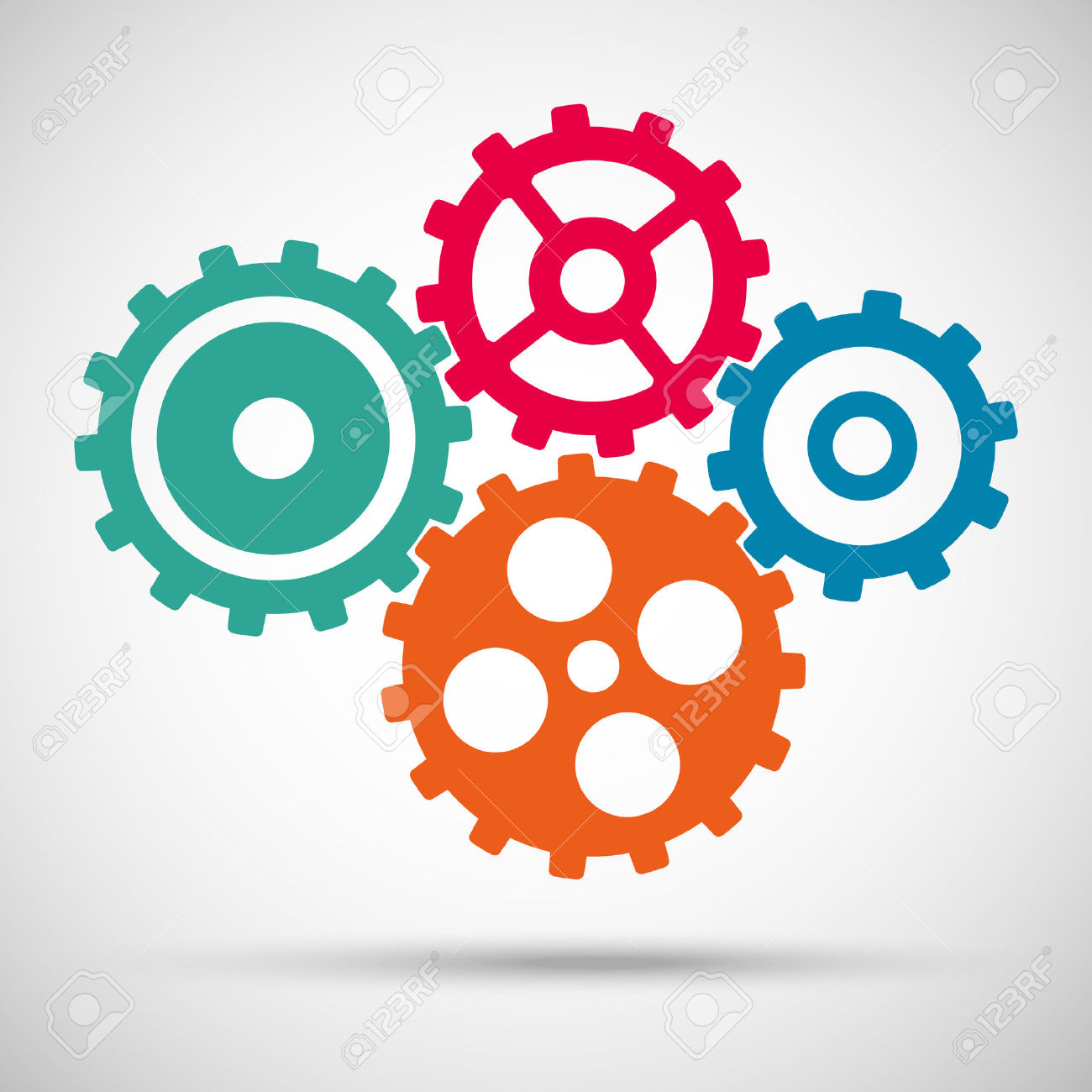 Different Colored Toothed Gears (cogs) Is Meshed On Gray.