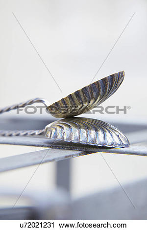 Stock Photography of Abstract View Of Metal Butterfly Spoons.