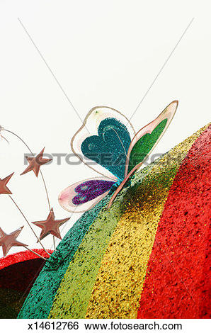 Stock Images of Metal butterfly and stars on top of rainbow.