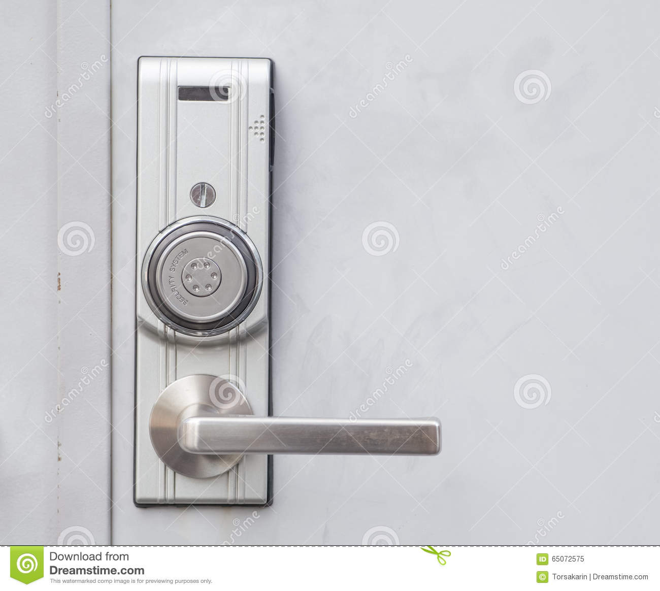 Door Handle With Security System Lock On Metal Door Stock Photo.