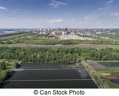 Stock Photography of Steel factory with smokestacks at sunny day.