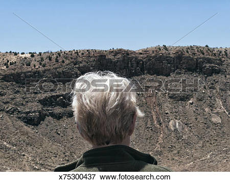 Picture of Tourist gazing into Meteor Crater, Arizona x75300437.