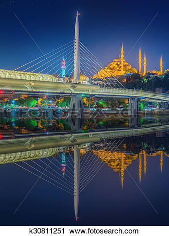Stock Photography of Ataturk bridge, metro bridge at night.