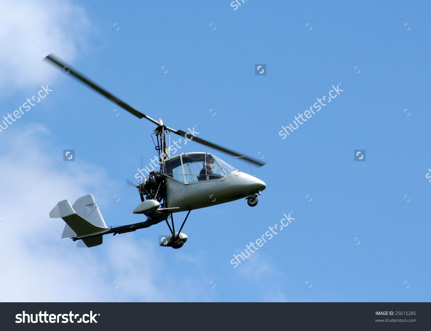 Ultralight Helicopter Being Flown Above Clouds Stock Photo.
