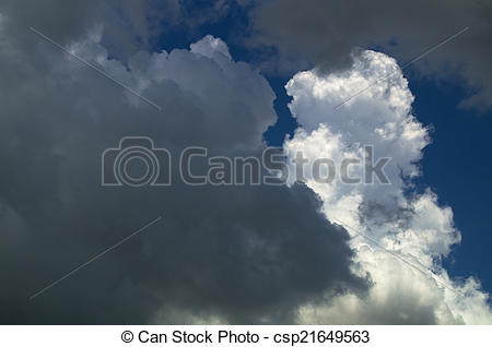 Stock Image of gathering storm clouds at midday.