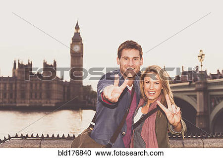 Stock Photography of Caucasian couple posing at clock tower.