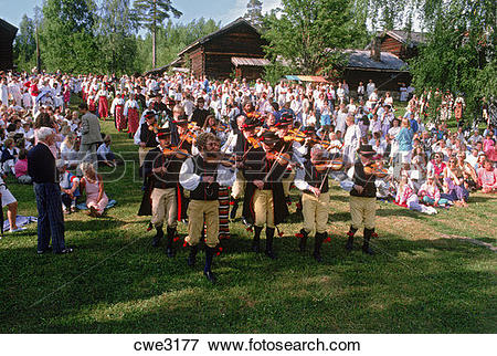 Picture of Fiddlers leading villagers at traditional Midsummer.