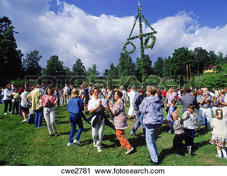 Stock Photography of Dancing around Maypole during Midsummer.