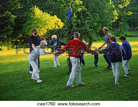 Stock Photography of Family dancing around Maypole for Swedish.