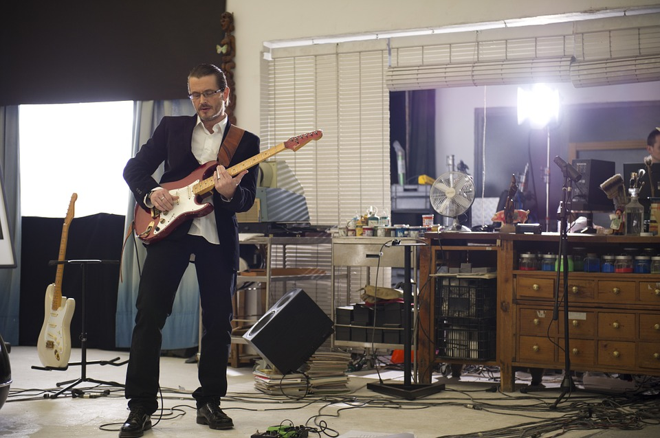 Free photo Blues Guitar Player Studio Mika Selander Guitar.