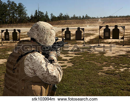 Stock Photo of A military policeman fires a rifle at the shooting.