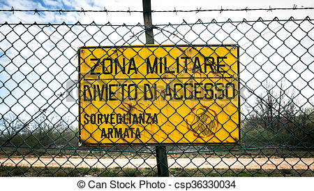 """Stock Photos of Sign that reads in Italian """"military zone, no."""