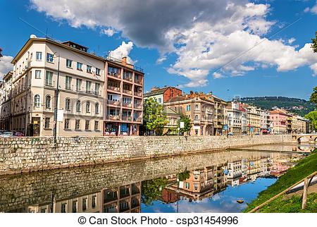 Stock Photographs of Buildings in Sarajevo over the river Miljacka.