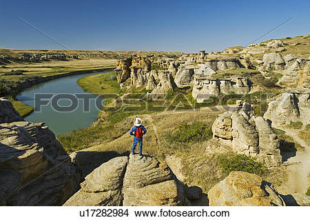 Stock Photo of hiker along the Milk River, Writing On Stone.