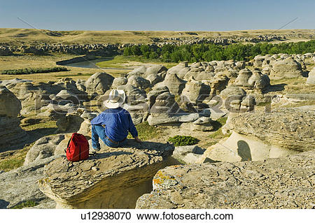 Stock Photography of hiker along the Milk River, Writing On Stone.