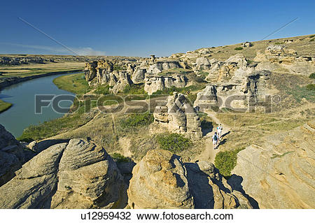 Stock Photo of hikers along trail near the Milk River, Writing On.