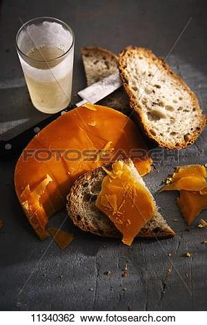 Stock Photo of Bread with mimolette (sliced cheese, French.