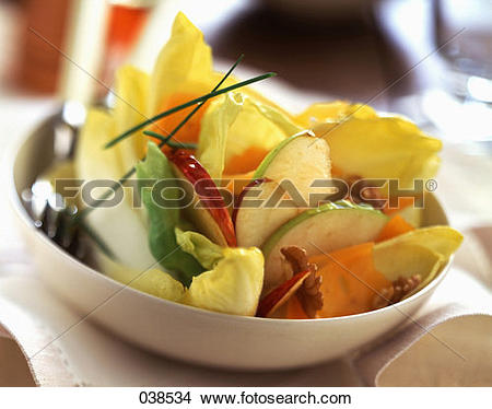 Stock Photo of French endive, apple, walnut and Mimolette cheese.