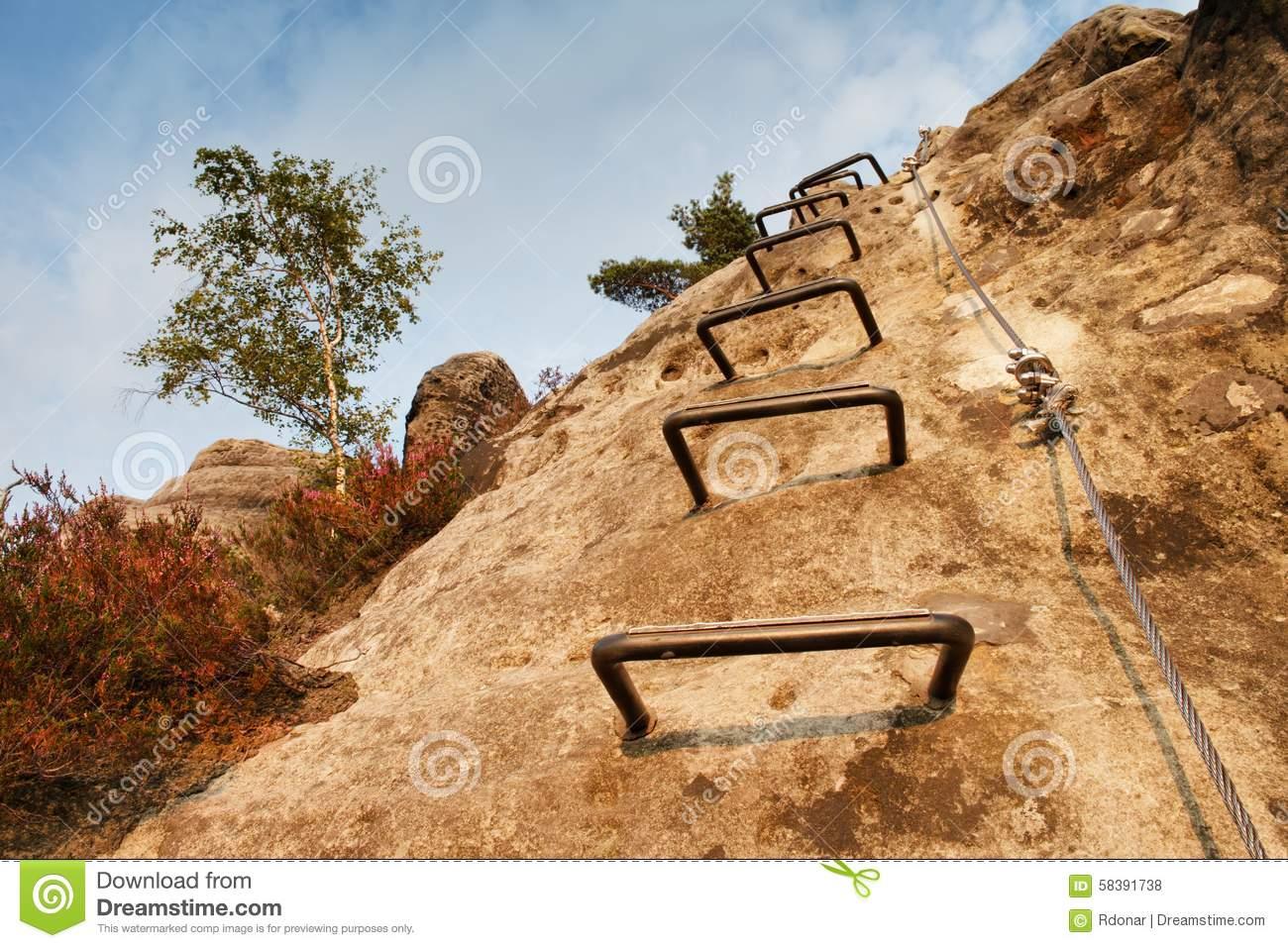 Climbers Metal Ladder Via Ferrata. Iron Twisted Rope Fixed In.