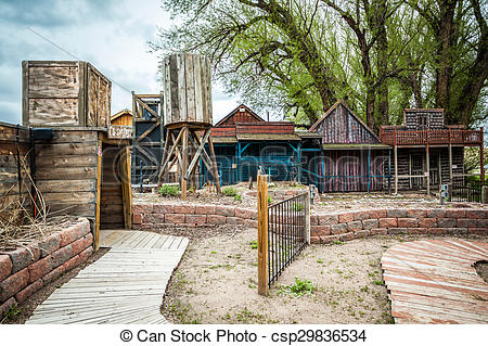 Stock Photos of Small old town with wooden buildings and entrance.