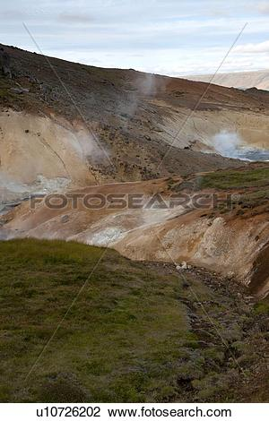 Stock Photo of Geological geothermal mineral pool vents in Iceland.