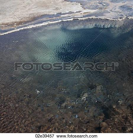Picture of Rippled pool of shallow water with mineral deposits on.