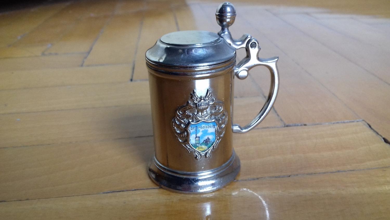 Miniature beer mug.