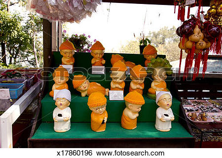 Stock Images of Miniature monk dolls for sale at a Buddhist temple.