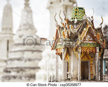 Picture of Miniature garden buddha temple.