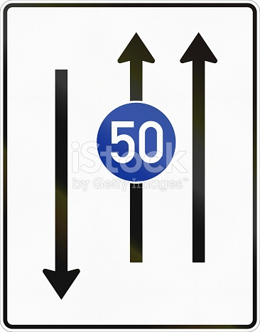 Two Lanes With Minimum Speed And Oncoming Traffic stock photo.