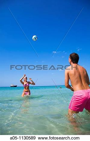 Stock Photograph of Playing volleyball. Binigaus beach. Minorca.