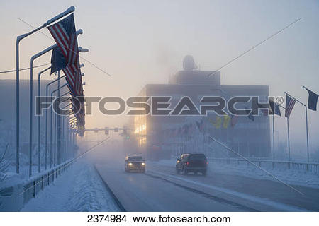 Stock Photo of Vehicle traffic in ice fog in downtown Fairbanks.