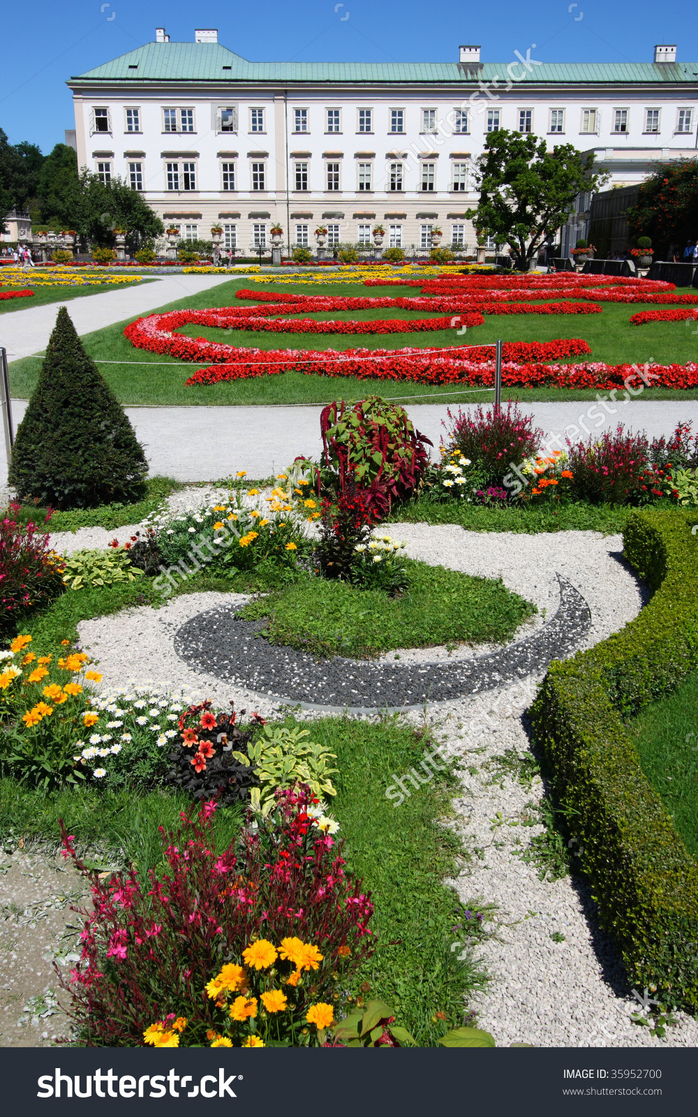 Ornamental Gardens, Beautiful Flowers And Mirabell Palace In.