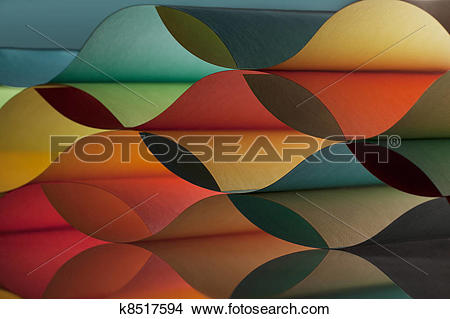 Stock Photo of curved, colorful sheets paper with mirror.