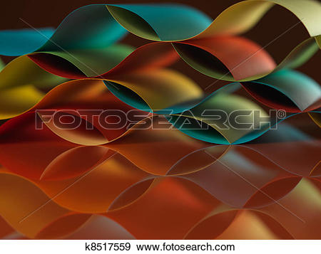 Stock Photograph of curved, colorful sheets paper with mirror.