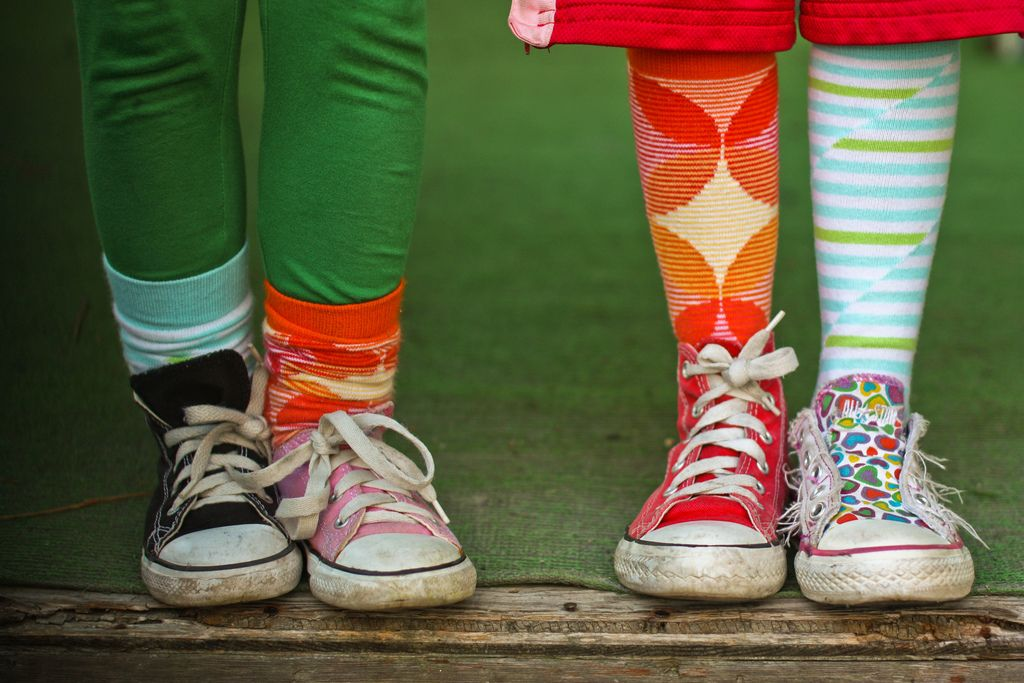 Mismatched shoes and mismatched socks.