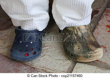 Stock Photography of mismatched shoes.