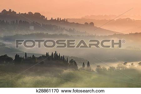 Stock Photography of Tuscany Village Landscape on a Misty Morning.
