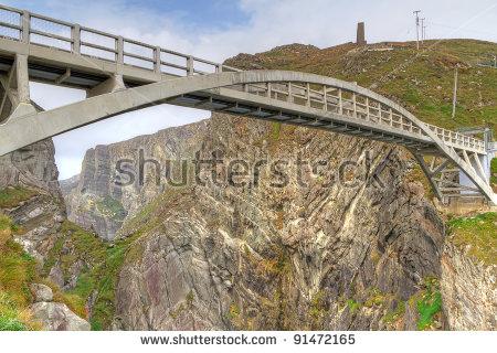 Bridge To At Mizen Head And Lighthouse, Co. Cork, Ireland Stock.