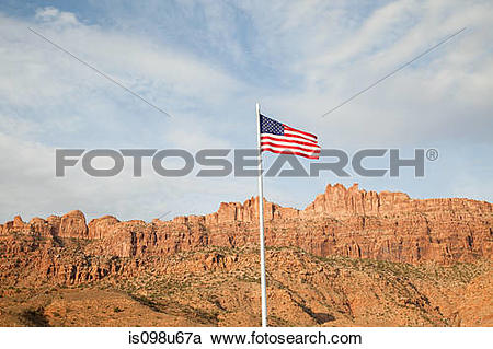 Stock Photography of American flag and Gold Bar Rim, Moab, Utah.
