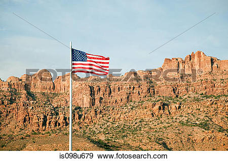 Stock Photograph of American flag and Gold Bar Rim, Moab, Utah.