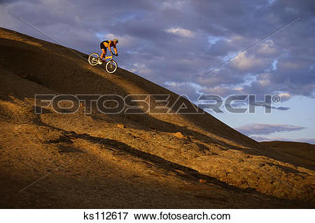 Picture of Mountain biking slickrock trail, sunrise. Moab, UT, USA.