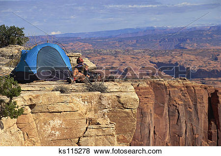 Pictures of Young couple camping at lookout over Long Canyon, Moab.