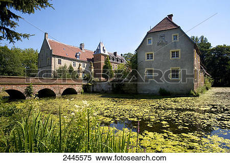 Stock Image of Moated castle at waterfront, Senden, Muenster.