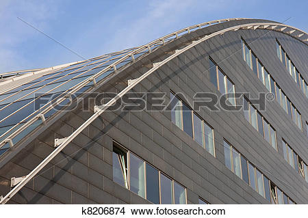 Stock Photo of Modern building with curved roof of glass k8206874.