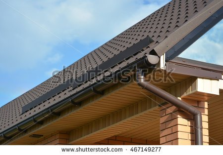 Pouring rain on a house roof clipart.