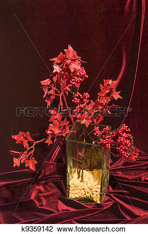 Stock Photo of still life in red tones with vase in modern style.