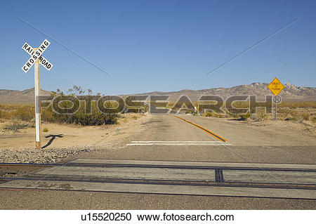 Stock Photography of Railroad crossing sign and intersection in.
