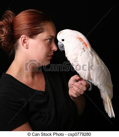 Stock Photography of Caucasian Woman Holding Her Pet Moluccan.